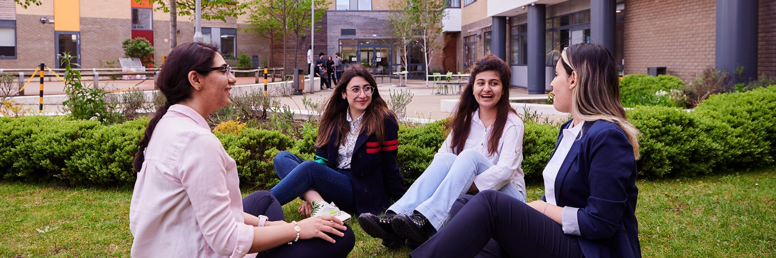 Students relaxing in the courtyard at at Abbey College Cambridge
